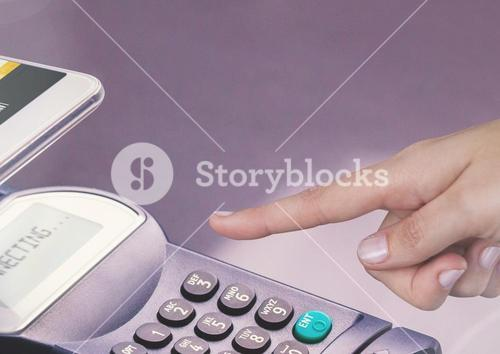 Hand touching card reader with purple background