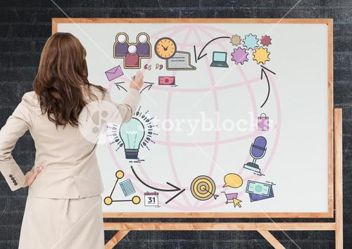 Business woman drawing graphic on the blackboard