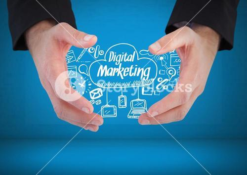 Hands holding Digital marketing text with drawings graphics