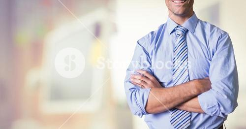 business men with his hands folded on blurred background of the office