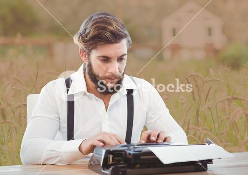 Man on typewriter with soft country background
