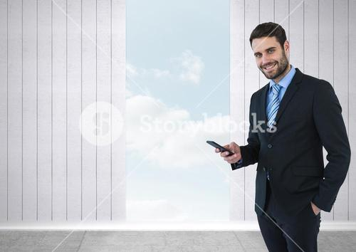 Businessman with phone and opening to sky