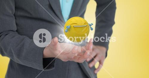 Close up of woman's hand with emoji and flare against yellow background
