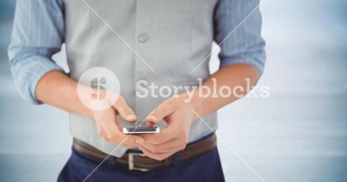 Man mid section with phone against blurry blue wood panel
