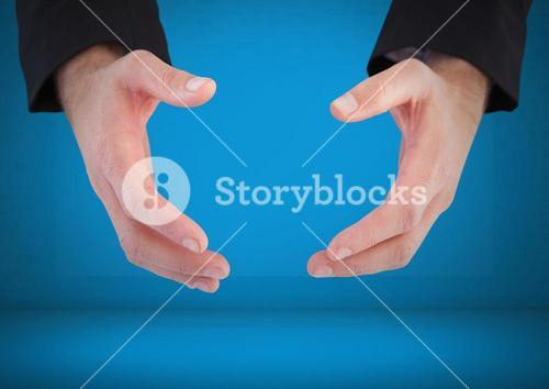 Hands arched apart against blue background