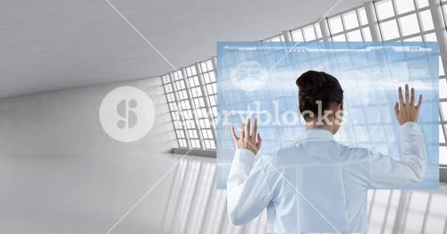 Doctor ( woman) using futuristic tactile screen at the hospital