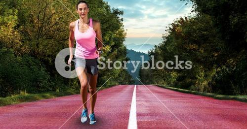 Determined female athlete running on country road