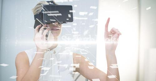 Digital composite image of businesswoman with VR glasses and smart phone