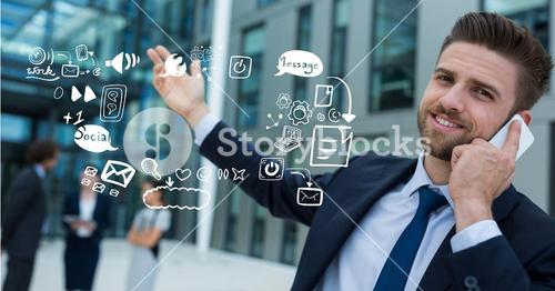Businessman using mobile phone by icons representing multi tasking