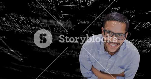 Digital composite image of businessman against blackboard with equations