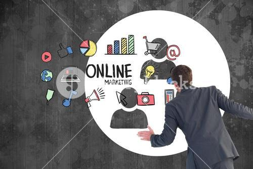 Rear view of businessman looking at various online marketing icons on blackboard