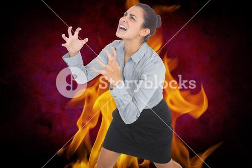 Digital composite image of aggressive businesswoman with fire