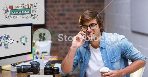 Creative businessman using smart phone by screens displaying icons
