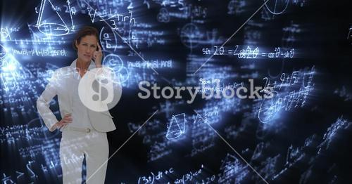 Digital composite image of confused businesswoman surrounded with equations