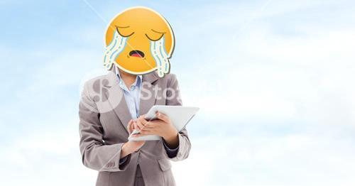 Digital composite image of businesswoman with crying emoji on face using tablet computer