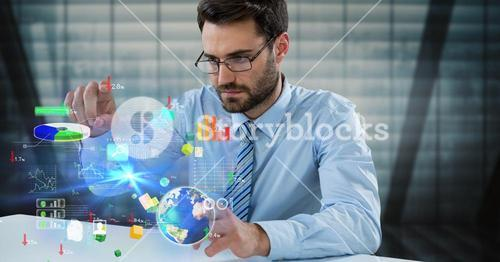 Digital composite image of businessman touching icons at desk