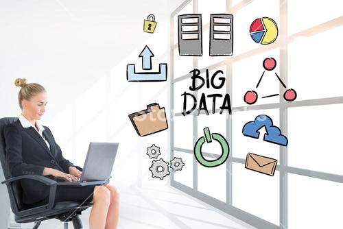 Businesswoman analyzing big data on laptop in office