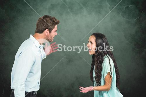 Side view of couple arguing against textured background