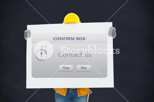 Carpenter holding placard with computer screen showing contact us message