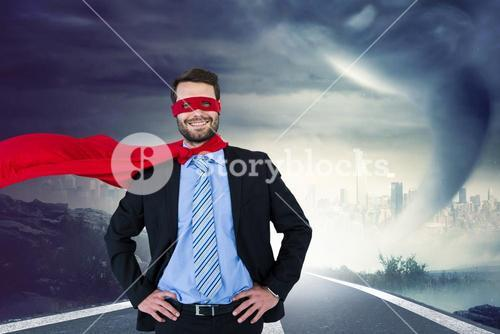 Portrait of happy businessman wearing superhero costume on country road