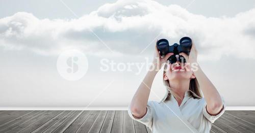 Smiling woman on floorboard using binoculars against sky
