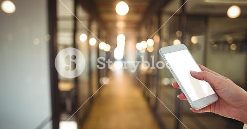 Cropped image of businesswoman using smart phone with blank screen