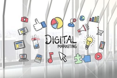 Digital marketing text surrounded with various icons in office