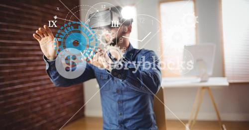 Man touching clock and gears seen through VR glasses