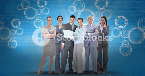 Digitally generated image of business people using laptop and smart phone against icons on blue back