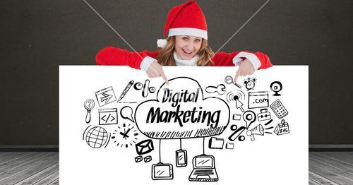 Portrait of happy woman wearing Santa hat showing digital marketing icons on placard