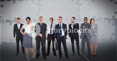Digitally generated image of business people with puzzle pieces in background