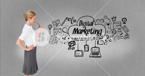 Thoughtful businesswoman looking at digital marketing and graphics