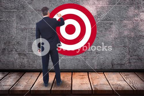 Rear view of businessman standing in front of bull's eye