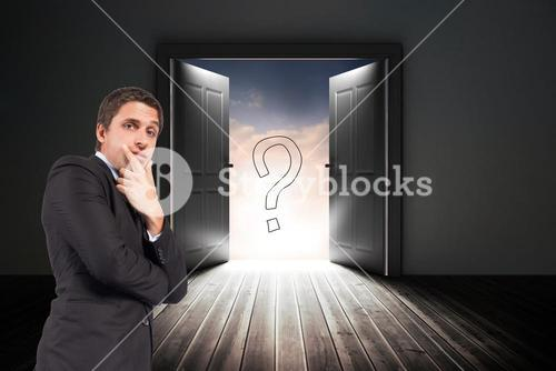 Confused businessman standing with door and question mark sign in background