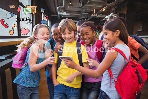 Happy school children using smart phone with social media icons