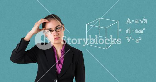 Businesswoman suffering from headache by equations on blue background