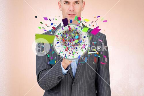 Businessman with confetti emerging from megaphone