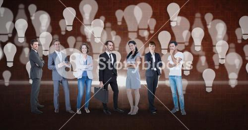Digital composite image of business people with light bulb background