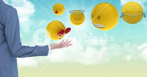 Cropped image of business person standing by various emojis
