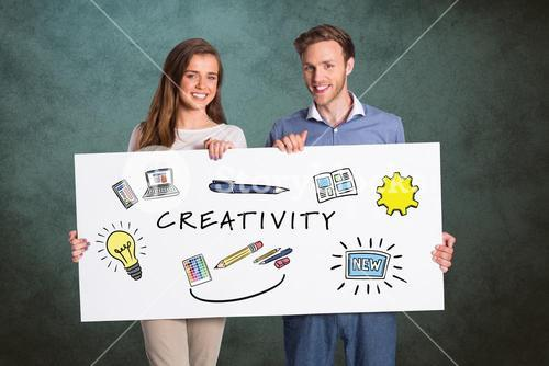 Couple holding bill board with signs and creativity text