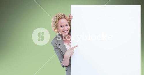 Businesswoman pointing at blank bill board