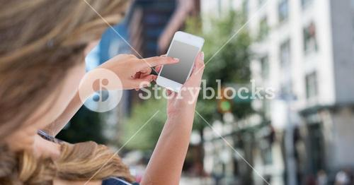 hand using smart phone with blank screen in city