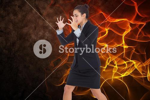 Angry businesswoman with fire