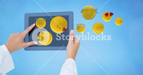 Emojis coming out from tablet PC while business person using it