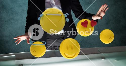 Midsection of businessman with emojis