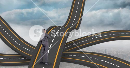 Digital composite image of businessman standing on wavy road