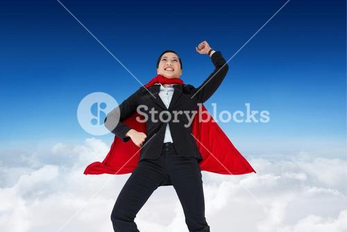 Businesswoman wearing  super hero cape in sky