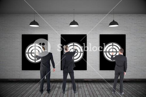 Rear view of businessmen setting targets