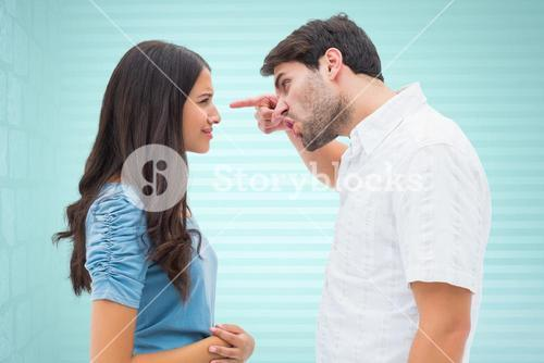 Couple arguing against colored background