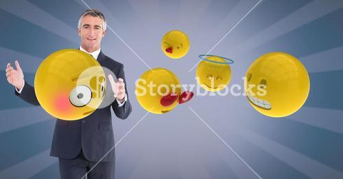 Digital composite image of businessman with emojis